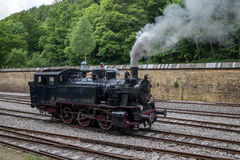 Steam locomotive. Retro vintage steam locomotive on rail tracks royalty free stock images