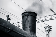 Steam locomotive in steam. Partial view of the boiler and chimne Royalty Free Stock Photos