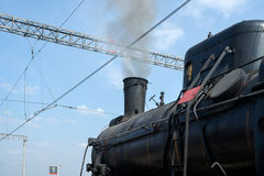 Steam locomotive in steam and ready to depart. Partial view of b Stock Image