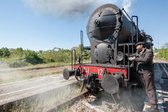 Steam locomotive stops on the tracks, in the countryside. Steam locomotive stops on the tracks, snorting smoke and hot steam stock photography