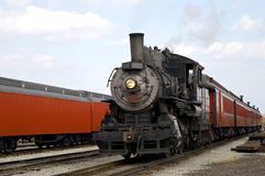 Steam locomotive and train. A view of a steam locomotive as it pulls a train through a rail yard into the train station in Strasbourg, Pennsylvania (USA stock photos