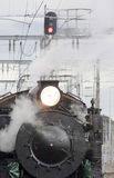 Steam Locomotive. A steam locomotive at a train station Royalty Free Stock Photography