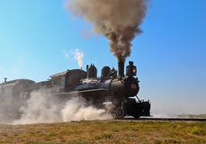 Steam locomotive train takes off. stock photography
