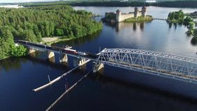 Steam locomotive Ukko-Pekka moves on a railroad bridge in Savonlinna, Finland. Beautiful aerial view Ukko-Pekka Steam Locomotive 10.07.2016.nFinnish Steam stock footage