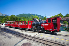 Steam locomotive of a vintage cogwheel railway going to Schafber Royalty Free Stock Image