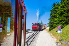 Steam locomotive of a vintage cogwheel railway going to Schafber Stock Photos