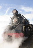 Steam Locomotive. Vintage steam locomotive letting off steam Stock Photo