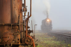 Steam locomotive and water tank Stock Image