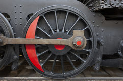 Steam locomotive wheel and connecting rod detail. Black and red Stock Photography