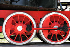 Steam locomotive wheels close-up. Red and white old steam locomotive wheels close-up Stock Photo