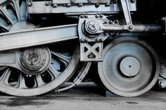Steam locomotive wheels and rods closeup Royalty Free Stock Images