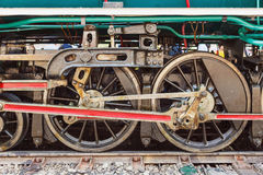Steam locomotive wheels and rods closeup Stock Photos