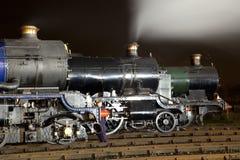 Steam Locomotives illuminated at night Royalty Free Stock Photo