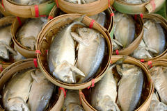 Steam mackerel in bamboo basket Stock Photo