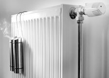 Steam from metal containers on radiator Royalty Free Stock Images