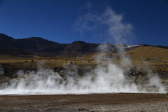 Steam with mountain landscape at El Tatio Chile Stock Images