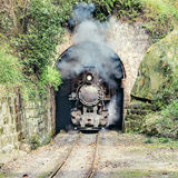Steam narrow-gauge train. Moves from Yuejin to Bagou through the tunnel. Jiayang Mining Region. Sichuan province. China Royalty Free Stock Images