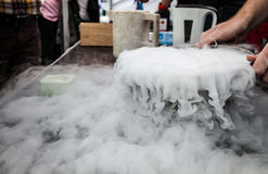 Steam of Nitrogen Created from Liquid Nitrogen Exposed to Ambient Temperatures. Lot of white steam created from liquid nitrogen Stock Images