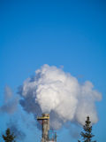 Steam out of Smoke stack Royalty Free Stock Photo