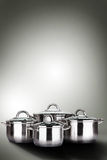 Steam over cooking pot. On background Stock Photos