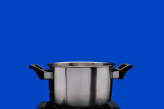 Steam over cooking pot ,blue screen. Shot Stock Photo