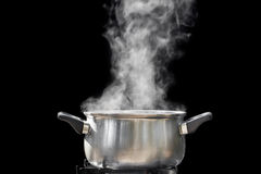 Steam over cooking pot Stock Photography