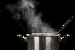 Steam over cooking pot Stock Image