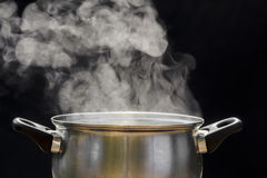Steam over cooking pot. On dark background Stock Photography