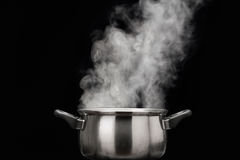 Steam over cooking pot Royalty Free Stock Photo