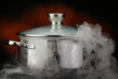 Steam over cooking pot Stock Photos