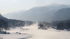 Steam over a mountain river. Winter, frosty sunny day stock video footage
