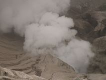 Steam over the volcano. Steam in the Bromo volcano on Java in Indonesia stock photo