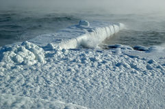 Steam over winter storm sea Royalty Free Stock Photo