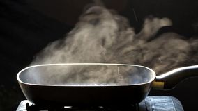 Steam on pan in kitchen stock footage