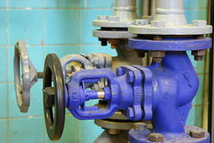 Steam pipe with a valve Stock Photos