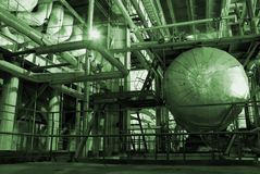 Steam Pipes. An assortment of different size and shaped pipes at a power plant Stock Photos
