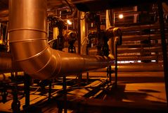 Steam Pipes. An assortment of different size and shaped pipes at a power plant Royalty Free Stock Image