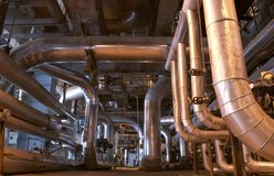 Steam Pipes. An assortment of different size and shaped pipes at a power plant Royalty Free Stock Photos