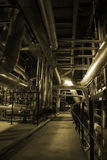 Steam Pipes. An assortment of different size and shaped pipes at a power plant stock photo