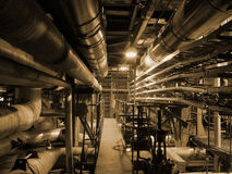 Steam Pipes. An assortment of different size and shaped pipes at a power plant Royalty Free Stock Photo