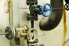 Steam pipes with pressure relief valves Royalty Free Stock Photo