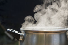Steam on pot in kitchen Stock Images