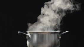 Steam on pot at kitchen.