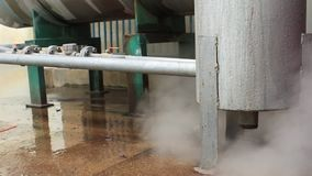 Steam power leak from industrial tank stock video footage