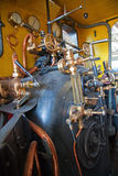 Steam powered engine. Steam powered traction engine boiler pressure controls Stock Image