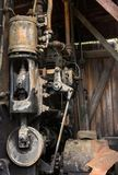 A steam-powered winch inside a crane at an outdoor museum in alaska Royalty Free Stock Photography