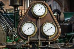 Steam Pressure Gauge. Old steam pressure gauge amid antique steam engines Stock Image
