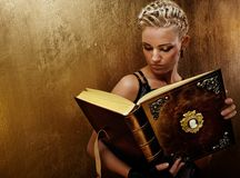 Steam punk girl with a book. Royalty Free Stock Image