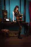 Steam punk girl with old book Royalty Free Stock Photos