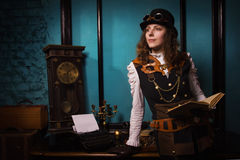 Steam punk girl with old book Stock Images